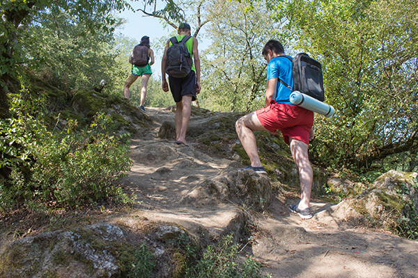 Travel adventure and hiking activity, active and healthy lifestyle on summer vacation and weekend tour. Tourists With Backpacks travel