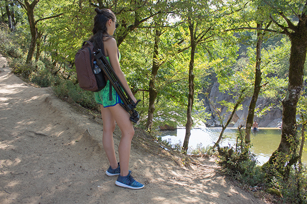 Eco tourism and healthy lifestyle concept. Young hiker girl with backpack